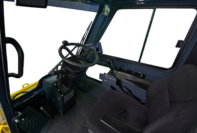 Spacious cabin of the Cameleon sidewalk plow tractor